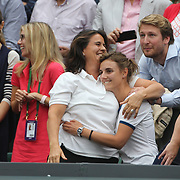 LONDON, ENGLAND - JULY 15:  Conchita Martinez, coach of Garbine Muguruza of Spain, (left), celebrates her victory while in the family box during the Ladies Singles final against Venus Williams of The United States in the Wimbledon Lawn Tennis Championships at the All England Lawn Tennis and Croquet Club at Wimbledon on July 15, 2017 in London, England. (Photo by Tim Clayton/Corbis via Getty Images)