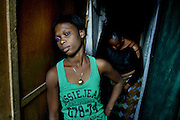 Angels of death<br /> <br /> Tens of thousands of HIV positive prostitutes in the slums of Lagos to ensure a rapid spread of the epidemic.<br /> <br /> &quot;If you arrive by car, you can smell the HIV virus outside,&quot; joked my driver as we are on track to Badia a criminal slums of Lagos. Badia is a corruption of &quot;Bad Area&quot;. Nigerians have a lack of everything, except black humor.<br /> <br /> The poor West African country Nigeria, with a population of 140 million people, after India and South Africa the highest number of people with HIV / AIDS. Since the beginning of the epidemic in 2000 is estimated to have 800,000 people died in Nigeria. But the worst is yet to come: within 5 years in Nigeria 5 million people die of AIDS. In 2015 there are 10 million.<br /> <br /> In the capital Lagos, the situation is acute: 1.2 million people are infected with the HIV virus - in the Netherlands compared with the population of Amsterdam would be infected.<br /> <br /> Two to five dollars<br /> Badia is one of the thousands of slums in Lagos, where both sides of the railroad verzakte prostitutes in small pens getimmerde display of old boards and rusty corrugated life. Women as young as 14 years, working to survive. They count from 2 to 5 per customer. How younger and prettier the girl, how expensive it is. The men visit prostitutes as if they walk in the bakery. Within 5 minutes they're out, the pants still dichtritsend. A hooker in Badia receives about 5 clients per day.<br /> <br /> Many still do not have money for the girls. Some 10 per day to rent for a room tendon and the salary of a square-built bouncer.<br /> <br /> Expats<br /> The youngest and hottest girls live in Badia, but outside the district. When the sun goes down in Lagos massive music concerns and beer bars are open, these girls in the suburbs in search of the white 'expat-man', often too fat and ugly, but with money. These girls have only one customer per night required for 50 to 100 euro it will go to his house or hotel.<br /> &copy;Ton koene/Exclusivepix Media