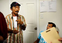 NEW ORLEANS, LA- June 22:  Dung Nguyen, left, argues his case for receiving  assistance along with other families... Vietnamese affected by the Gulf oil spill because of their work in the fishing industry, wait on an early morning line at Mary Queen of Vietnam Catholic Church to receive financial assistance from Catholic Community Services, in New Orleans, Louisiana, Tuesday June 22, 2010.  (Melina Mara/The Washington Post)