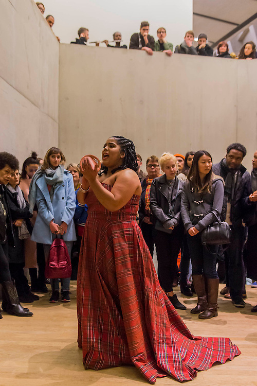 Aluminum - New York-based choreographer Rashida Bumbray (pictured red dress) collaborates with Simone Leigh on an immersive dance performance. The performance begins in the Tanks at and proceeds through the Switch House, pausing on Level 4 around and concluding in Tate Exchange. London 26 Nov 2016.