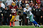 Dallas Cowboys' wide receiver, Cole Beasley, dives for a long pass late in the second quarter against the Washington Redskins at FedEx Field in Landover, Maryland on December 28, 2014.  UPI/Pete Marovich