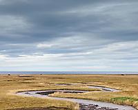 Small stream on Snæfellsnes Peninsula, Iceland. Cloudy skies. Lækur á Snæfellsnesi. Þungbúinn himinn.