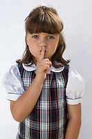 Elementary Student with Finger on Lips