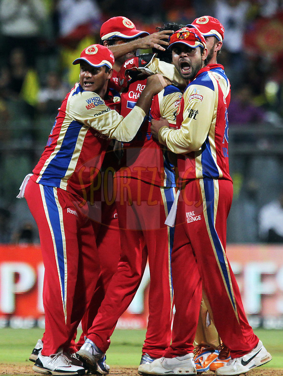 Royal Challengers Bangalore players celebrates after getting a wicket during the Qualifier 1 match of the Indian Premier League ( IPL ) Season 4 between the Royal Challengers Bangalore and the Chennai Super Kings held at the Wankhede Stadium, Mumbai, India on the 24th May 2011..Photo by BCCI/SPORTZPICS.