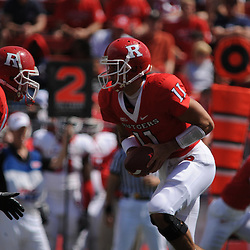 Apr 18, 2009; Piscataway, NJ, USA; Rutgers QB Domenic Natale (11) hands the ball off to RB Joe Martinek (not pictured) during the first half of Rutgers' Scarlet and White spring football scrimmage.