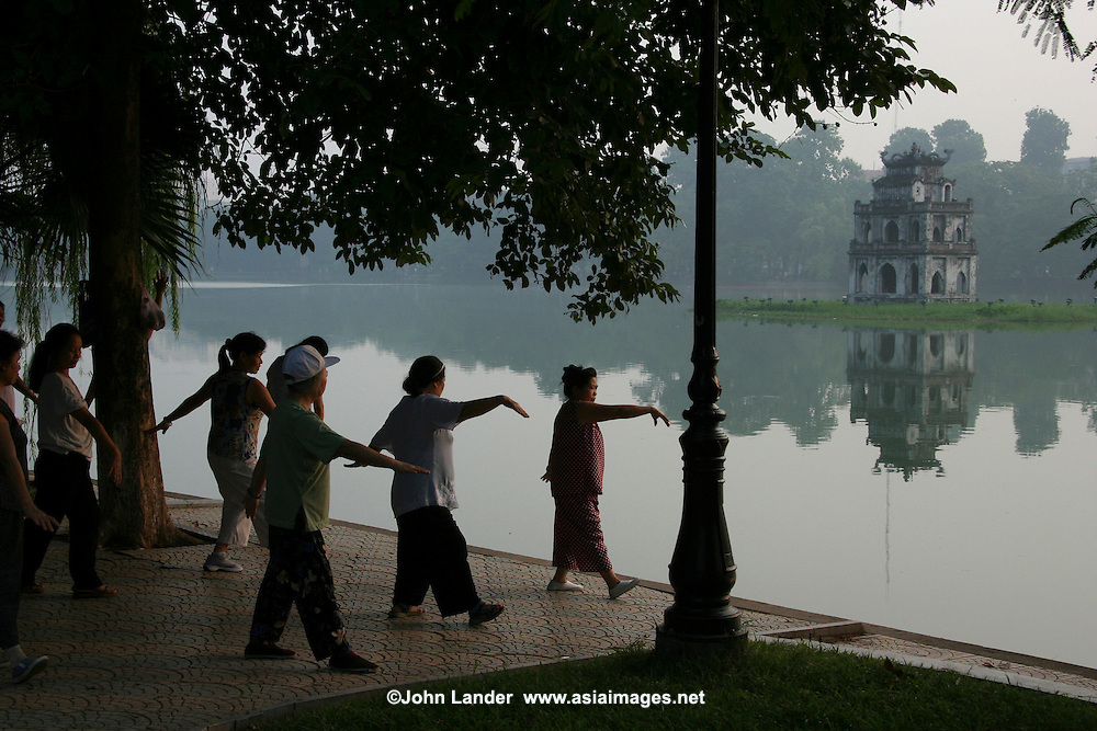 "Tai chi is popular with mostly Vietnamese ladies.  Hoan Kiem Lake or ""Lake of the Returned Sword"" is located in the historical center of Hanoi, the capital of Vietnam and one of the more scenic spots in the city and also serves as a focal point for its public life."