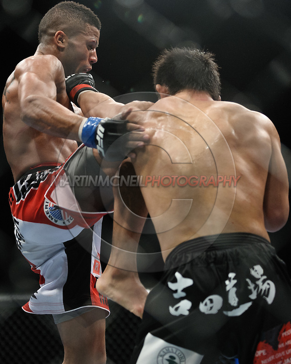 "BIRMINGHAM, ENGLAND, NOVEMBER 5, 2012: Jason Young (left) is caught by a left jab from Michihiro Omigawa during ""UFC 138: Munoz vs. Leben"" inside the National Indoor Arena in Birmingham, United Kingdom"