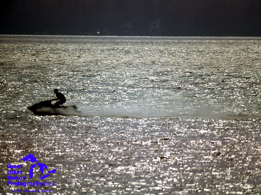 With exposure set to capture only a silhouette, this image highlights a very nice way to cool off on a 90+ degree day on Lake Gogebic in Michigan's Upper Peninsula.