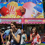 Teenage girls enjoy cotton candy during the May Fair at Saint Mark's Church, New Canaan, Connecticut, USA. 12th May 2012. Photo Tim Clayton