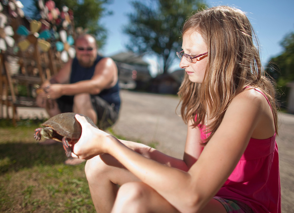 Ailsa Craig, Ontario ---10-07-10---  Haley Wahl holds her turtle &quot;Speedy&quot; at her Ailsa Craig, Ontario home as she prepares it for the town's Turtle races which take place July 17, 18.<br /> GEOFF ROBINS Toronto Star