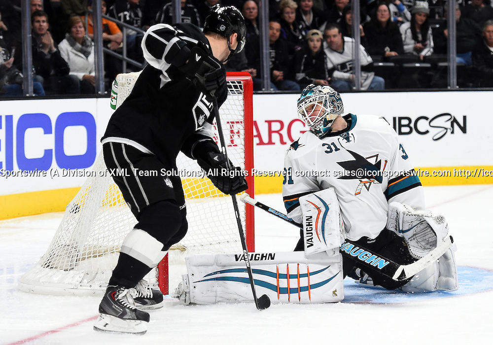 27 December 2014: San Jose Sharks Goalie Antti Niemi (31) [6575] misses the puck for a Kings goal in the third period on a shot by Los Angeles Kings Defenseman Jake Muzzin (6) [15654] (not pictured) during an NHL game between the San Jose Sharks and the Los Angeles Kings at STAPLES Center in Los Angeles, CA.