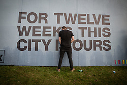 "© Licensed to London News Pictures . 05/06/2015 . Manchester , UK . A man urinates against a poster reading "" For twelve weeks this city is ours "" . Evening concerts featuring headliners , The Courteeners , playing a homecoming gig , at Heaton Park in Manchester in front of 25,000 people , the evening before the Parklife music festival . Photo credit : Joel Goodman/LNP"