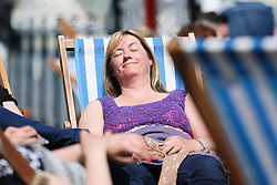 © Licensed to London News Pictures. 17/05/2015. Brighton, UK. Thousands of people are visiting the beach in Brighton and take advantage of the sunny and warm weather, today May 17th 2015. Photo credit : Hugo Michiels/LNP