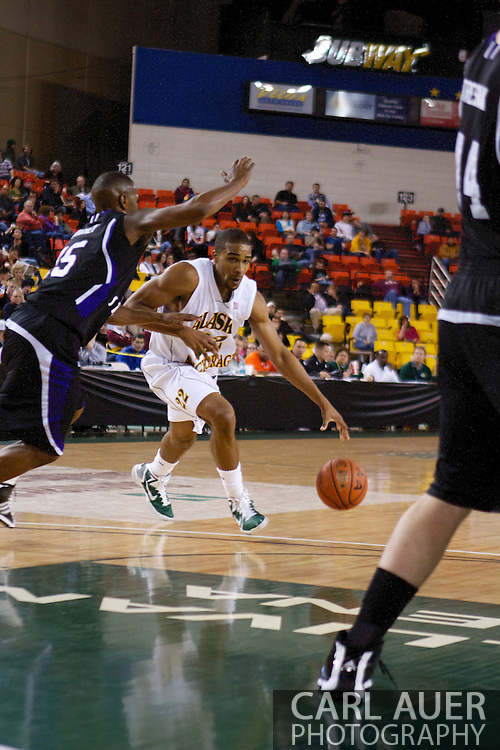 November 25th, 2010:  Anchorage, Alaska - University of Alaska-Anchorage guard Brandon Walker (22) drives to the lane in the Seawolves 54-86 loss to Weber State in the first round of the Great Alaska Shootout.