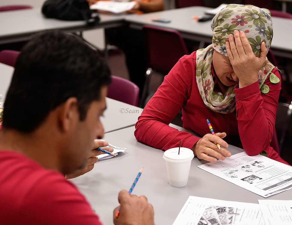 1005612433 :: 7/27/16 :: REGION :: LYNCH :: Hassan Mahmoud and his wife Fahima Jemmo attend English for Speakers of Other Languages class at New London Adult and Continuing Education Wednesday, July 27, 2016. Hasan Mahmoud and Fahima Jemmo and their children Fidan, 17, Hanif, 15 and Fulla, 7, are refugees from the conflict in Syria and lived for three years in Turkey before finally receiving approval to come to the United States. (Sean D. Elliot/The Day)