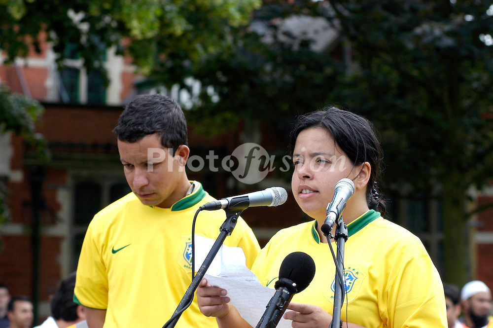 Patricia Armani and Alex Pereira; cousins of Jean Charles de Menezes; speaking at a rally to protest against the raid of a house in Forest Gate; London; by the anti terrorist police; June 2006