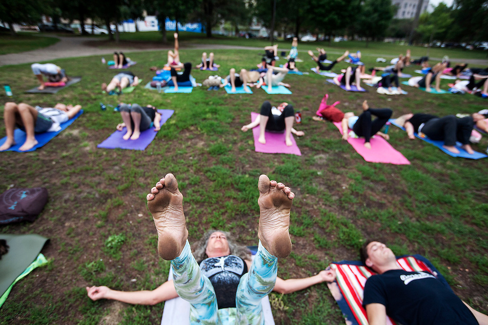 Dirty feet are clear evidence of an outdoor yoga session completed as participants rest in savasana, or final resting pose, at Yoga Rocks the Park in Father Hennepin Park in Minneapolis August 22, 2014.