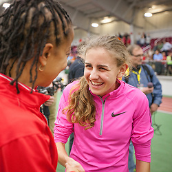 Mary Cain greets fans after wetting World Junior record for 1000 meters indoors