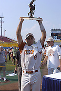 Texas third basemen David Maroul holds up the MVP Trophy of the College World Series.  Texas defeated Florida 6-2 for the National Championship at the College World Series at Rosenblatt Stadium in Omaha, Nebraska on June 26, 2005.