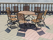 a round table with eight chairs place around it