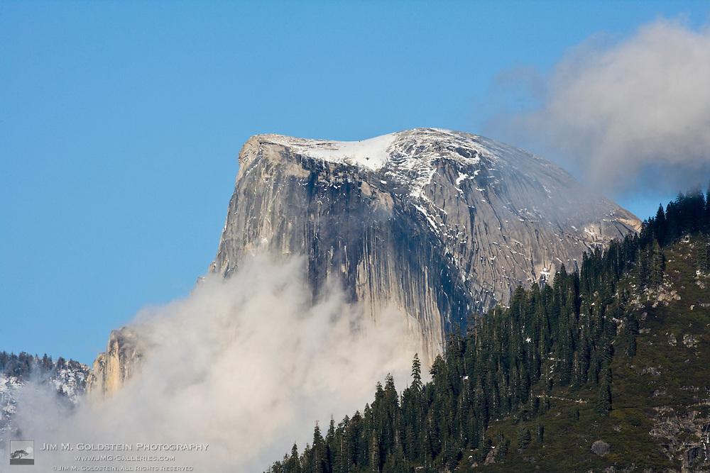 Clouds and fog gather around Half Dome  - Yosemite National Park, California