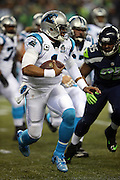 Carolina Panthers quarterback Cam Newton (1) runs the ball in the first quarter during the NFL week 19 NFC Divisional Playoff football game against the Seattle Seahawks on Saturday, Jan. 10, 2015 in Seattle. The Seahawks won the game 31-17. ©Paul Anthony Spinelli