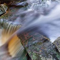 Shays Run cascades over moss covered rocks near Elakala Falls, Blackwater Falls State Park, West Virginia.