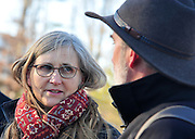 """Mike Litt , Consumer Program Advocate, U.S. PIRG, speaks with  Elisabeth Caspari and Marcus Moench during a press conference outside of the Volkswagen headquarters after trying to return their 2010 Volkswagen in Herndon, Va on Jan 19, 2016. Marcus and Elisabeth own one of the 567,000 diesel vehicles in the U.S. that Volkswagen sold as """"clean"""" but was secretly designed with a """"defeat device"""" to emit as much as 40 times the legal limit for smog-forming pollutants.  Photo by Kris Connor"""