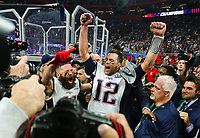 New England Patriots' Julian Edelman, left, and Tom Brady celebrate after the NFL Super Bowl 53 football game against the Los Angeles Rams, Sunday, Feb. 3, 2019, in Atlanta. The Patriots won 13-3. <br /> (Tom DiPace via AP)