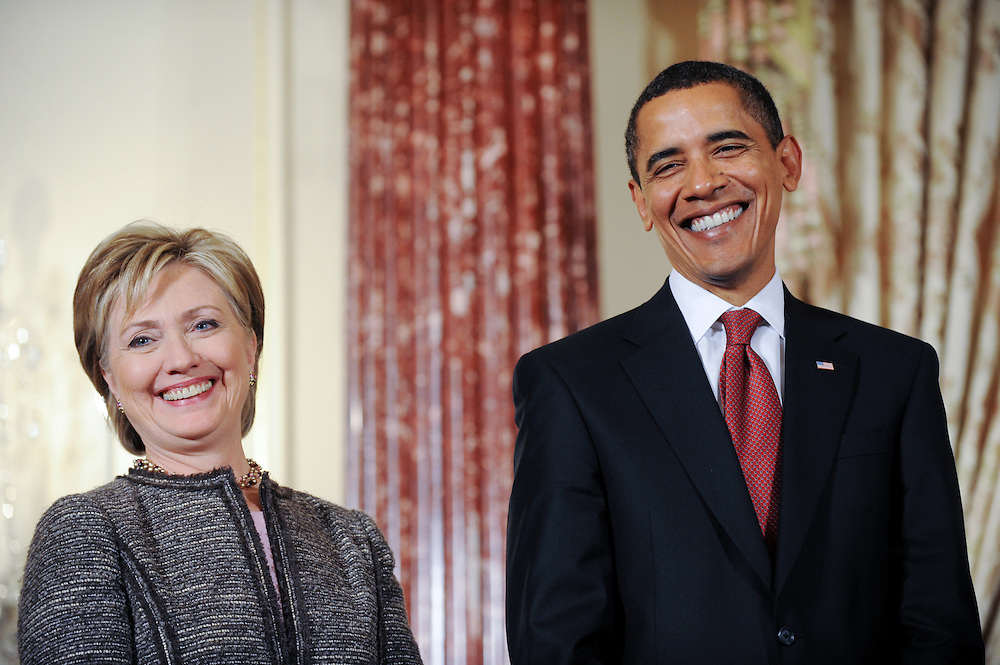 U.S. President Barack Obama and his Secretary of State Hillary Clinton smile during an event where they announced the appointment of two new envoys to the Middle East, India and Pakistan, at the State Department  in Washington, DC, USA on 22 January 2009. Former Senator George Mitchell will serve as envoy to the Middle East and former Ambassador Richard Holbrook will serve Pakistan and India.