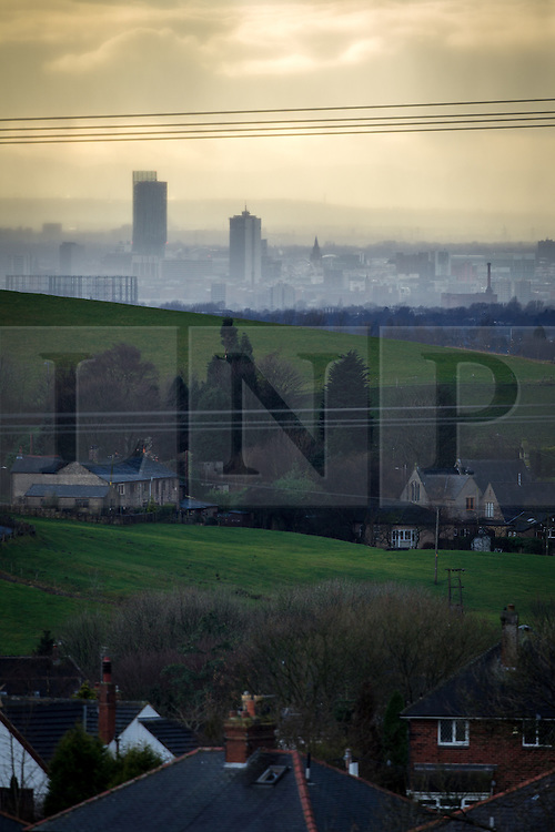 © Licensed to London News Pictures . 20/02/2014 . Manchester , UK . Landscape view across Manchester taken from Saddleworth near Oldham , featuring the city's iconic Beetham Tower on the left and the Piccadilly Tower and Town Hall to its right . Photo credit : Joel Goodman/LNP
