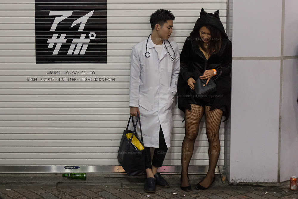 A man dressed a s a doctor talks to a woman in costume during the Halloween celebrations Shibuya, Tokyo, Japan. Saturday October 27th 2018. The celebrations marking this event have grown in popularity in Japan recently. Enjoyed mostly by young adults who like to dress up, drink , dance and misbehave in parts of Tokyo like Shibuya and Roppongi. There has been a push back from Japanese society and the police to try to limit the bad behaviour.