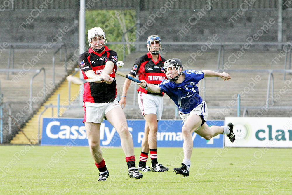 Pictured at the Cratloe V Whitegate match at Cusack Park on Saturday 6th August 2011 was Whitegate's Ian Fahy about to hit the ball with defence from Cratloe's Sean chaplin.<br /> Pic. Emma Jervis/ Press 22