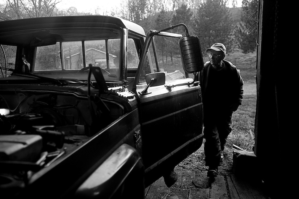 Dave Bircher, 71, checks out his truck while a farm hand works on the inside. Bircher has farmed the rolling hills of Southeast Ohio for more than thirty years and has needed extra help as he grows older. 'Honestly, we're farming because we love to farm. We're not farming because we're making any money,' says Bircher.