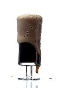 Pint of dark beer - studio shot