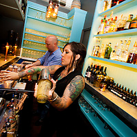 ORLANDO, FL -- Bartender Sheena Cuccia and owner Tyler Brassil mix whiskey drinks at The Pharmacy in Orlando, Florida.  (PHOTO / Chip Litherland)