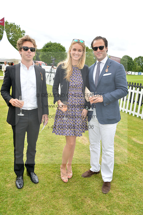 Left to right, JAMES FABRICANT, LILA WARBURTON and DANIELE BENATOFF at the Cartier Queen's Cup Final polo held at Guards Polo Club, Smith's Lawn, Windsor Great Park, Egham, Surrey on 15th June 2014.