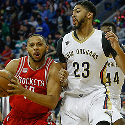 Mar 17, 2017; New Orleans, LA, USA; Houston Rockets guard Eric Gordon (10) drives in against New Orleans Pelicans forward Anthony Davis (23) during the first quarter of a game at the Smoothie King Center. Mandatory Credit: Derick E. Hingle-USA TODAY Sports