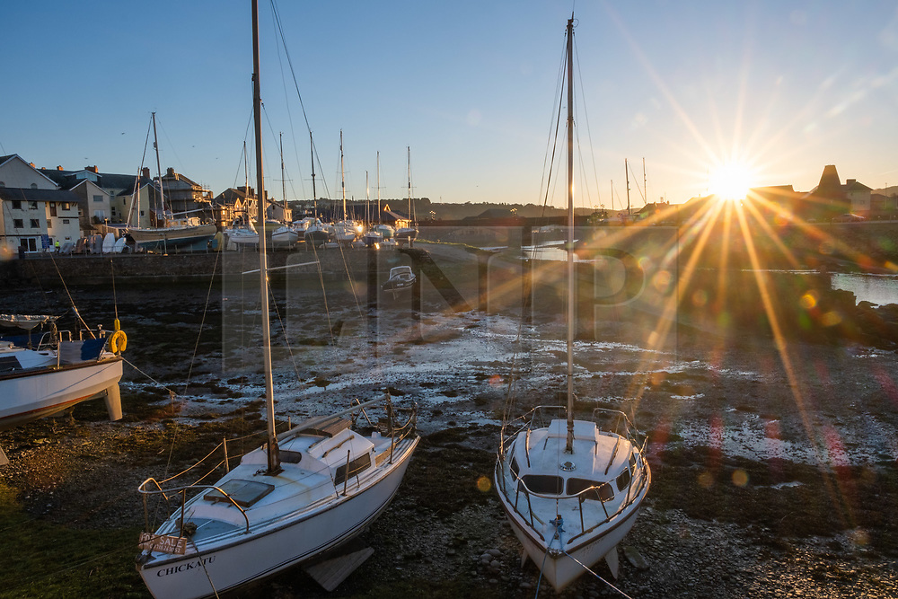 © Licensed to London News Pictures. Aberystwyth Wales UK,  26/02/2019. Daybreak over boats moored at Aberystwyth harbour , Ceredigion West Wales, on yet another day of clear skies. Yesterday the area around the town experienced the hottest ever recored February temperatures in the UK, reaching 20.3ºc at Trawsgoed. Photo credit Keith Morris / LNP