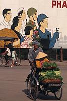 Cyclo and propaganda poster in Nha Trang, Vietnam