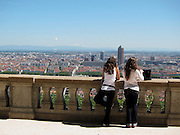 Tourists enjoy a view of Lyon, France, seen from the Basilica of Notre-Dame de Fourvière