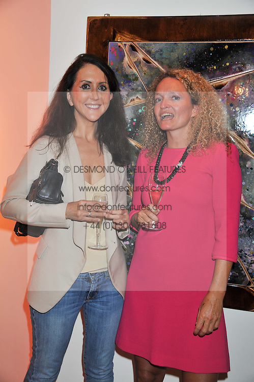 Left to right, LIZ JONES and STEPHANIE THEOBALD at a party to celebrate the publication on The House of Rumour by Jake Arnott held at The Ivy Club, West Street, London on 9th July 2012.