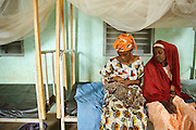 Mariam Keita, 20, breast feeds her newborn child at the Badegna community health center in the town of Kita, Mali on Sunday August 29, 2010. At right is Mariam's stepmother Loli Camara.