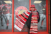 Walsalll fan with scarf before before the Sky Bet League 1 play-off second leg match between Walsall and Barnsley at the Banks's Stadium, Walsall, England on 19 May 2016. Photo by Nigel Cole.