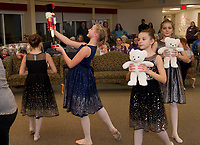 """Josephina Scoog as """"Clara"""" dances with her nutcracker during the party dance scene as the Lakes Region Dance Company performs for the Taylor Home on Monday evening.  (Karen Bobotas/for the Laconia Daily Sun)"""