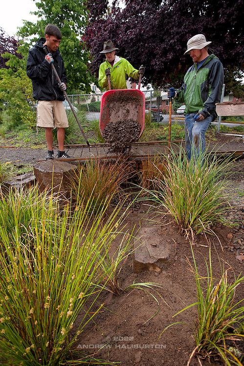 Adrian Lucas, Josh Lighthipe and Tyson Leggate volunteer at the rain garden work meet, Café au Play at Tabor Commons, a project of the Southeast Uplift Neighborhood Coalition (SEUL) and volunteers from Portland's Mt Tabor neighborhood.