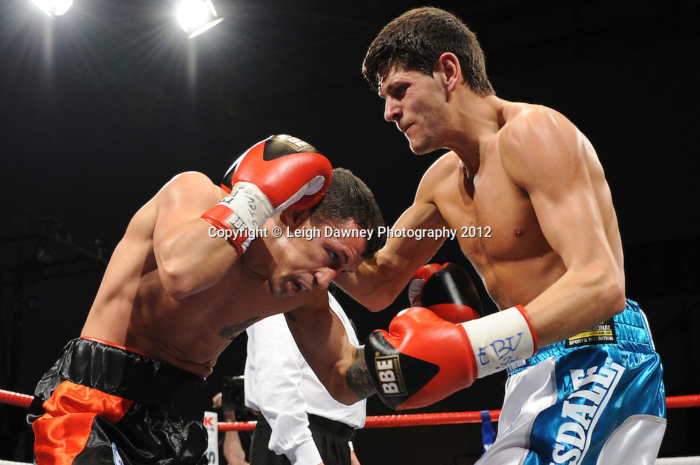 Jamie McDonnell (white shorts) defeats Ivan Pozo for the European Bantamweight Title, on 3rd March 2012 at the Hillsborough Leisure Centre. Frank Maloney & Dennis Hobson Promotions © Leigh Dawney Photography 2012.Jamie McDonnell (white shorts) defeats Ivan Pozo to retain the European Bantamweight Title, on 3rd March 2012 at the Hillsborough Leisure Centre. Frank Maloney & Dennis Hobson Promotions © Leigh Dawney Photography 2012.