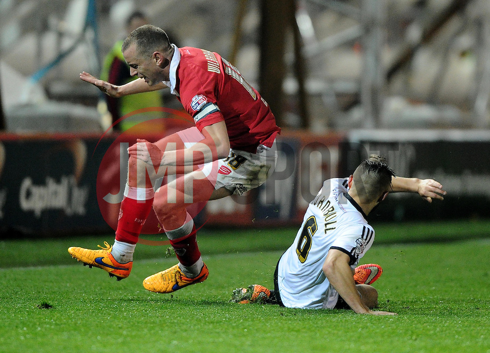 Bristol City's Aaron Wilbraham is fouled by Swindon Town's Jordan Turnbull  - Photo mandatory by-line: Joe Meredith/JMP - Mobile: 07966 386802 - 07/04/2015 - SPORT - Football - Bristol - Ashton Gate - Bristol City v Swindon Town - Sky Bet League One