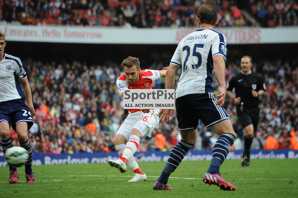 Arsenals Aaron Ramsey shoots, but hits the bar during the Arsenal v West Brom match on Sunday 24th May 2015