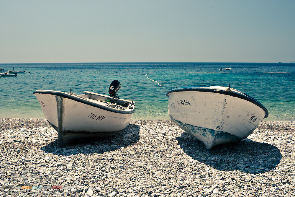 Fishing boats on the shore in the sleepy village of Milna, Hvar Island.